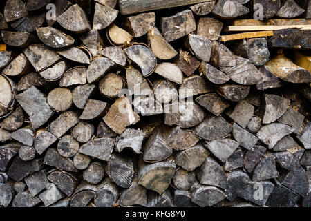 A pile of hard fire wood, weathered, background, graphical - Stock Photo
