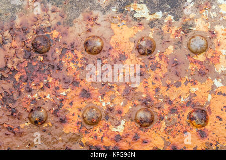 A rusty steel girder with rivets on sea defences, England, UK - Stock Photo
