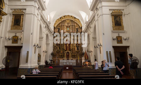 Interior of Basilica de Nuestra Senora Del Pilar in Buenos Aires Argentina next to Recoleta Cemetery.  Worshipers - Stock Photo