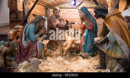 Close up of nativity scene in Buenos Aires church with traditional Mary, Joseph and Christ child surrounded by animals - Stock Photo