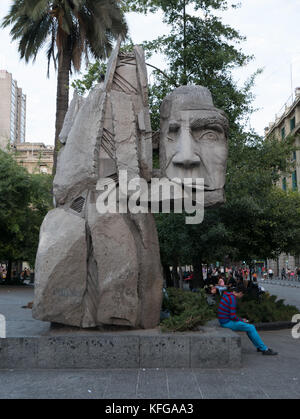 Famous statue located in the Plaza de Armas area of Santiago, Chile. Close-up of head of statue show man's face - Stock Photo