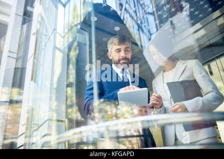 Successful Business People Behind Glass - Stock Photo