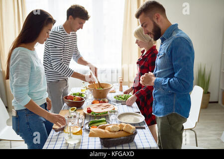 Group of Friends Making Dinner - Stock Photo