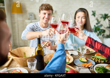 Friends Toasting at Thanksgiving Dinner - Stock Photo
