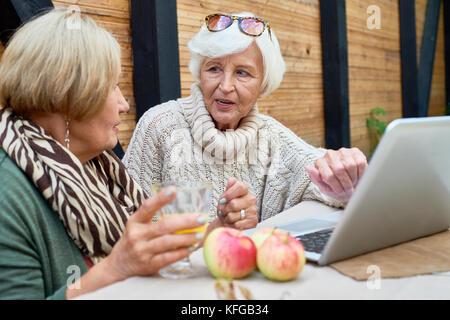 Senior Women Using Laptop - Stock Photo