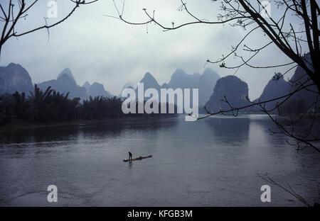 11.04.1995, Yangshuo, Guangxi, China, Asia - A traditional fisherman is seen drifting on his raft down the Lijiang - Stock Photo