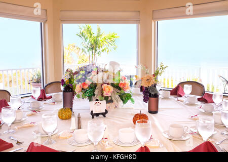 Beautiful restaurant event table setting in front of bright window - Stock Photo