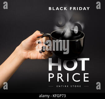 Banner for Black Friday hot sale. Black, steaming mug, price-tag in front of it. Grey background. - Stock Photo