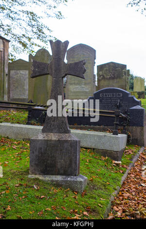 Ancient graves in the cemetery of Drumbo Parish Church in the County Down village of Drumbo in Northern Ireland - Stock Photo