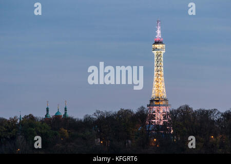 Lookout Tower on Petrin hill at dusk with the night illumination - Stock Photo