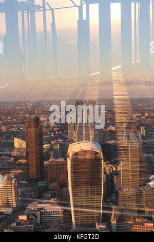 View of the City of London from The Shard viewing platform at sunset in London - Stock Photo