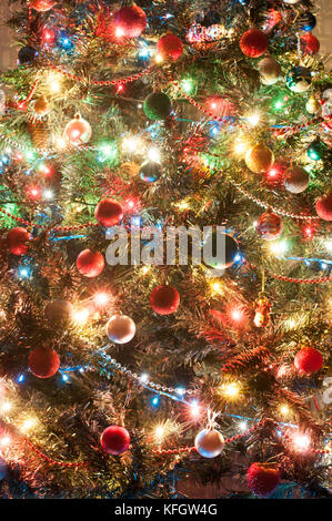 Part of decorated christmas tree- lights and toys - Stock Photo