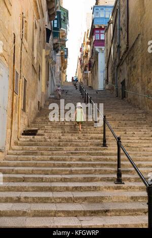 Girls / children / kids / child / kid walking up and down stairs steps / long stairway stair way on: Mikiel Anton - Stock Photo