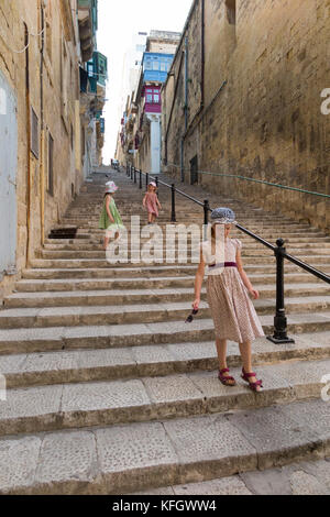 Girls / children / kids / child / kid walking up and down stairs steps / long stairway stair way on: Mikiel Anton - Stock Photo
