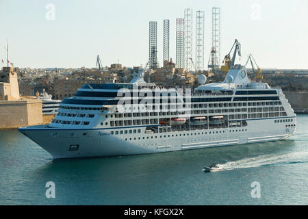 Cruise ship MS Nautica which is sailing out of Malta's Grand Harbour. owned & operated by Oceania Cruises, she is - Stock Photo