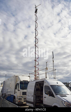 HD broadcasting vehicles with live video feed antennas on location. - Stock Photo