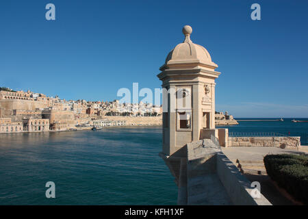Fortifications around the Grand Harbour, Malta, Europe. Sentrybox at Senglea Point, with the historic walled city - Stock Photo