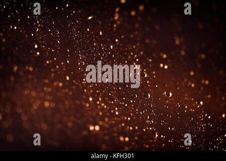 Brown background with water drops, rainy weather at night, rain drops on the window, abstract textured wallpaper, - Stock Photo