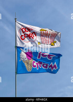 SOUTHEND-ON-SEA, ESSEX:  Advertising Flags flying above beachfront shop selling Ice Cream and Popcorn - Stock Photo