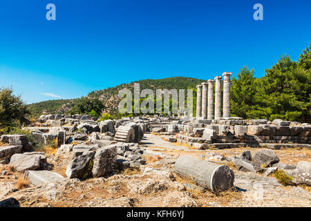 Ruins of the Athena Temple in ancient city of Priene destroyed by an earthquake. - Stock Photo