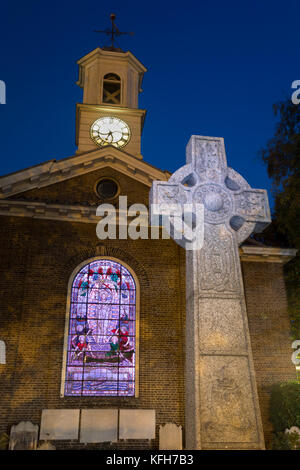 St George's Deal church with celtic cross and illuminated stained glass window at night, Deal, Kent, England, United - Stock Photo