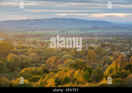 View over Cotswold town of Broadway and Bredon Hill in autumn from Fish Hill, Broadway, Cotswolds, Worcestershire, - Stock Photo
