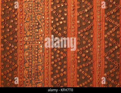 Indonesian textile with gold metallic thread applique. Sumatra  Southeast Asia - Stock Photo