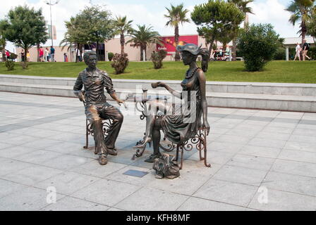 BATUMI, GEORGIA - September 1, 2017:  'Me, You and Batumi' sculpture on Batumi boulevard - Stock Photo