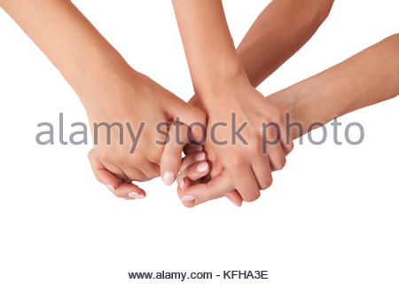 Two pairs of hands grasped together - Stock Photo