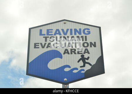 Leaving Tsunami Evacuation Area Sign. - Stock Photo