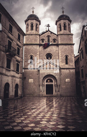 Old European St. Nicholas Orthodox Church in front of dramatic sky in old European city Kotor in Montenegro  (Montenegro, - Stock Photo