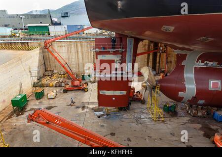 The ship on the stocks in the dry dock. Cam Ranh shipyard, Vietnam - Stock Photo