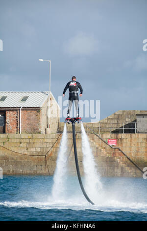 Penzance, Cornwall, UK. 29th October 2017. UK Weather. Instructors from 'Have a Go' penzance out making the most - Stock Photo