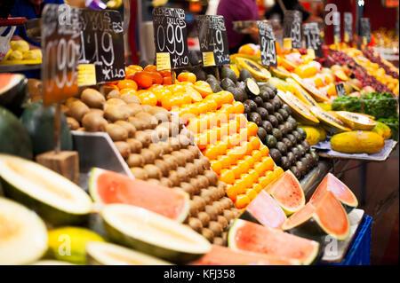 Fruits stall in la Boqueria covered market - Stock Photo