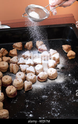 close up of female hands making cookies ,candid photography - Stock Photo