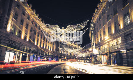 Regent Street Angels Holiday Lights with Car Light Trails in London, United Kingdom - Stock Photo