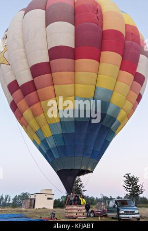 A hot air balloon pilot prepares for take off in a hot air balloon in San Miguel de Allende, Mexico. - Stock Photo