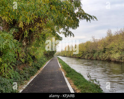 Bicycle path along the Naviglio Grande from Abbiategrasso to Turbigo (Lombardy, Italy), at Robecco sul Naviglio: - Stock Photo
