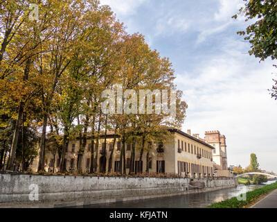 Bicycle path along the Naviglio Grande from Abbiategrasso to Turbigo (Lombardy, Italy), at Robecco sul Naviglio: - Stock Photo