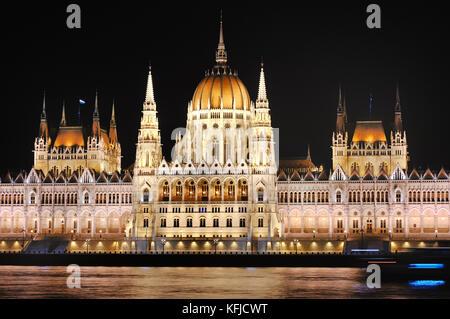 Parliament near Danube river scenic view at night, Budapest, Hungary, Europe - Stock Photo