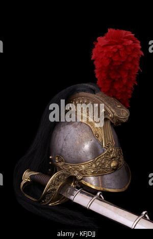 Composition with saber (sabre, cavalry sword) of French infantry officer (model 1855) and French cuirassier helmet - Stock Photo