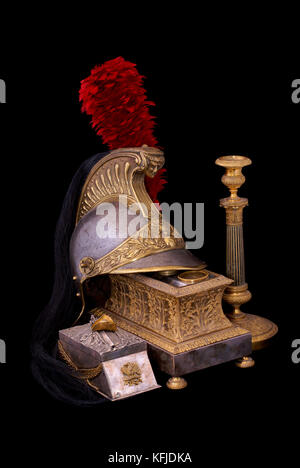 Composition with French cuirassier helmet (1836), bronze inkstand with gilding (1830) and old bronze candlestick - Stock Photo