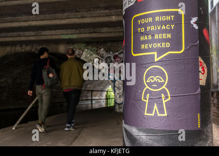 Street art poster hung on column near a tunnel from artist SUBDUDE with stylised man and cartoon with slogan 'Your - Stock Photo