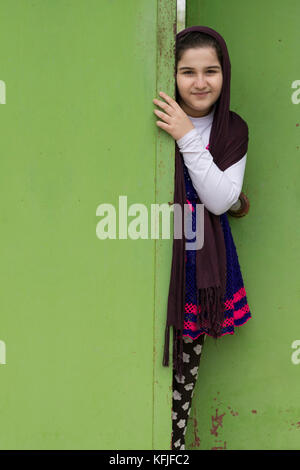 Portrait of a Beautiful Muslim Girl In Front of a Doorway - Stock Photo