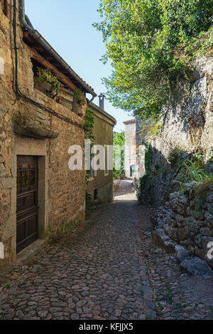 The narrow street in the picturesque village of Labeaume in the Ardeche region of France - Stock Photo