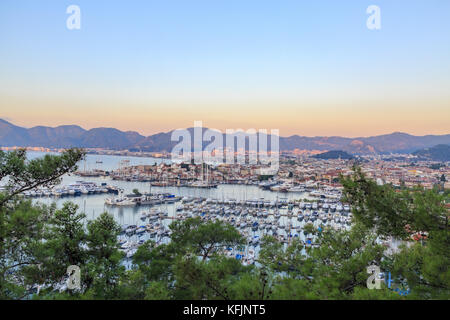 Aerial cityscape of Marmaris with pine trees - Stock Photo