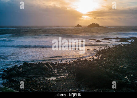 Stormy sunset over the sea at Cape Cornwall, UK - Stock Photo