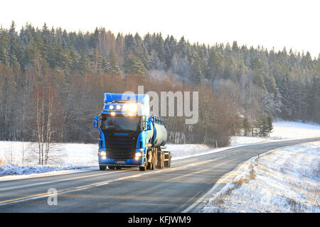SALO, FINLAND - JANUARY 9, 2016: Blue Scania R500 tank truck on the road in wintery South of Finland. According - Stock Photo