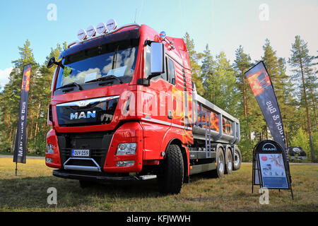 HYVINKAA, FINLAND - SEPTEMBER 11, 2015: New MAN TGX D38 35.560 tipper truck for construction on display at the exhibition - Stock Photo