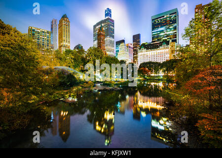 The Pond by night, as viewed from Gapstow Bridge in Central Park, New York City - Stock Photo